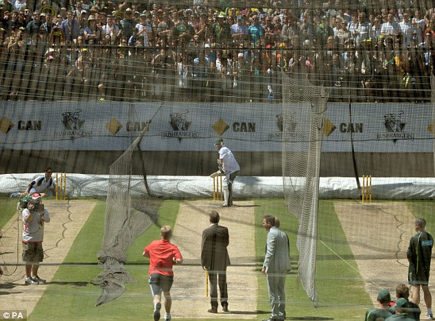 Steaming in: Lee runs up to bowl in the nets adjacent to the Melbourne Cricket Ground as a huge crowd watches