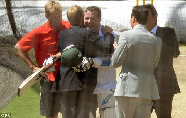 Survived: Morgan gets a hug from Australian legend Shane Warne while Lee laughs after the challenge