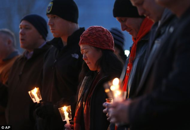Memorial: Dozens attended a candlelit vigil in Tupelo, Mississippi on Christmas Day for the father-of-two