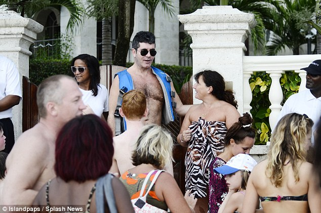 Mr Popular: Simon caused quite a stir among fans as he hit the beach on Friday