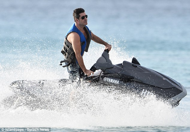 Water baby: The music mogul seemed to be having a whale of a time as he took to the ocean on his jet ski over the weekend