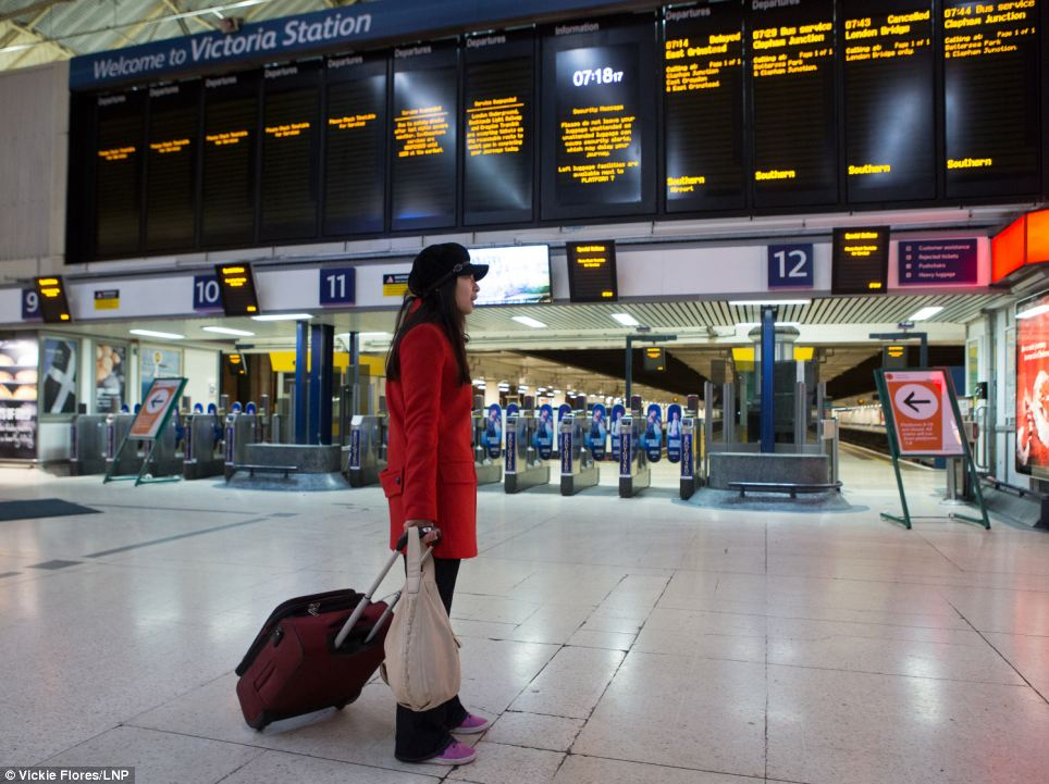 Southeastern Trains, which operates the rail network in Kent, cancelled all its services this morning into London Victoria, where a lone passenger is pictured above