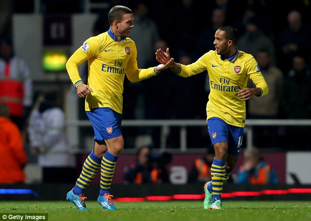 Explosive: Theo Walcott (right) has strong points scoring potential and is in good form right now