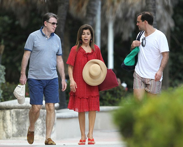 Chatting: Lord Mandelson appeared relaxed in a polo shirt, shorts and sunglasses, while the princess opted for a red dress and broad-rimmed sunhat