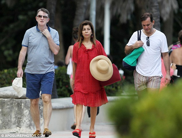 Sun-seeker: Peter Mandelson (left) enjoys a stroll through Miami Beach with Princess Firyal of Jordan and his partner Reinaldo da Silva