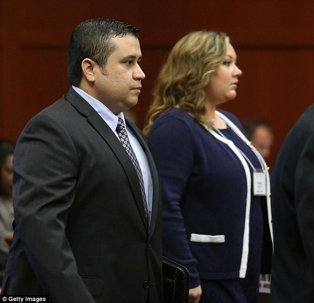 Stand by your man: George and Shellie Zimmerman are pictued on the eleventh day of his trial in Sanford, Florida