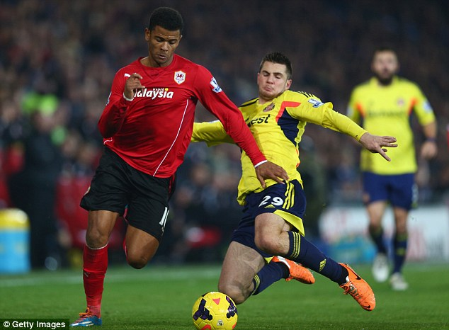On the run: Cardiff striker Fraizer Campbell (left) uses his pace to try and get away from Sunderland's Valentin Roberge