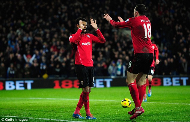 Relief: Campbell (left) celebrates his goal in reserved fashion with team-mate Mutch