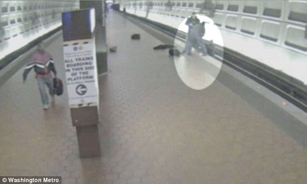 Passengers rush to help the woman off the tracks before a train enters the station in Washington