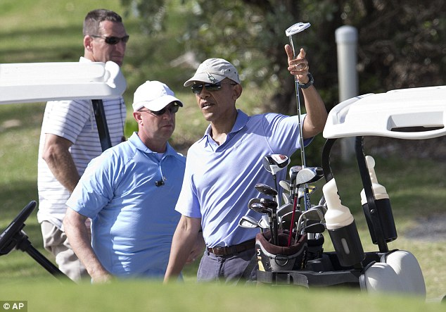 Family vacation: U.S. President Barack Obama played golf at the Mid-Pacific County Club in Kailua, Hawaii, on December 23