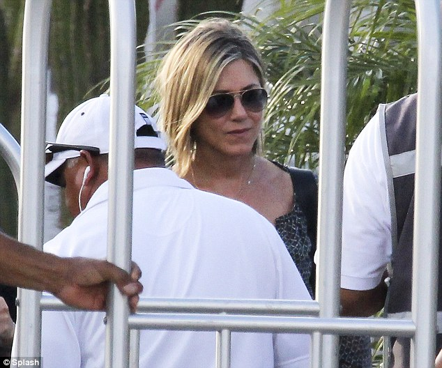 New 'do: Aniston's shorter cut kept her look free and easy for the trip
