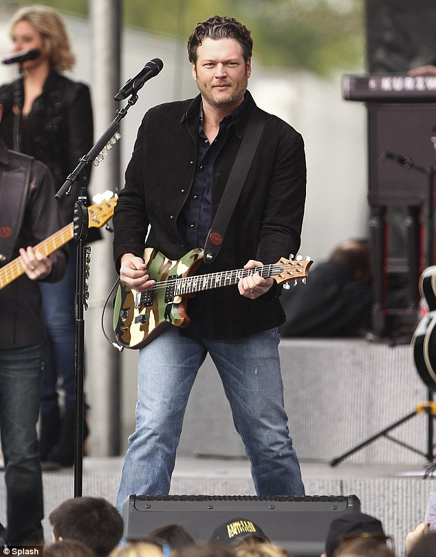 He's got the beat: Blake was in his element on stage as he played the electric guitar
