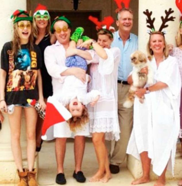 Snap happy: Maybe Rachel was trying to keep up with Cara Delevingne - whose family released a jolly snap of the whole leggy blonde clan in Barbados wearing beachwear and reindeer antlers