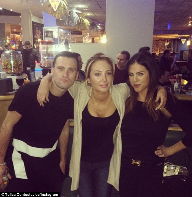 Pals: Tulisa poses with psychic Alex Thornhill (far right) in a photo captioned 'fun times'