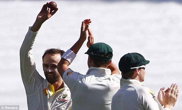 Take that! Nathan Lyon celebrates claiming five English wickets in the second innings on day three