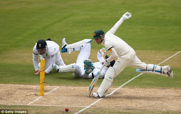 Miss: Michael Clarke (right) survives a run out attempt by Prior (centre) during the second Ashes Test