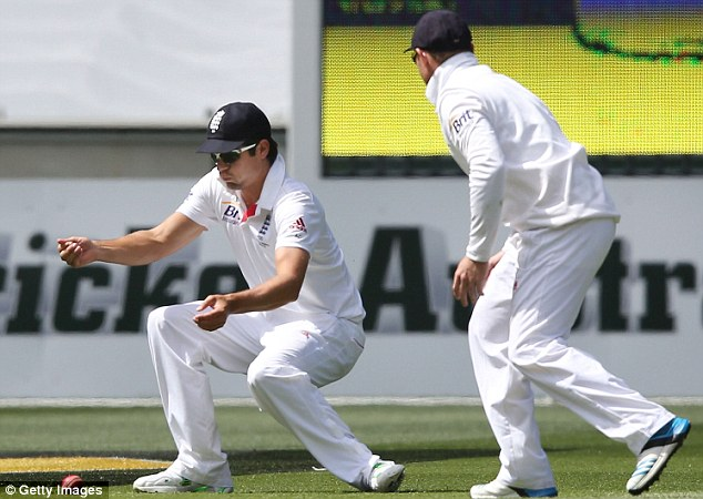 Oops: Cook dropped two catches, the second of which an absolute sitter, as England wilted early