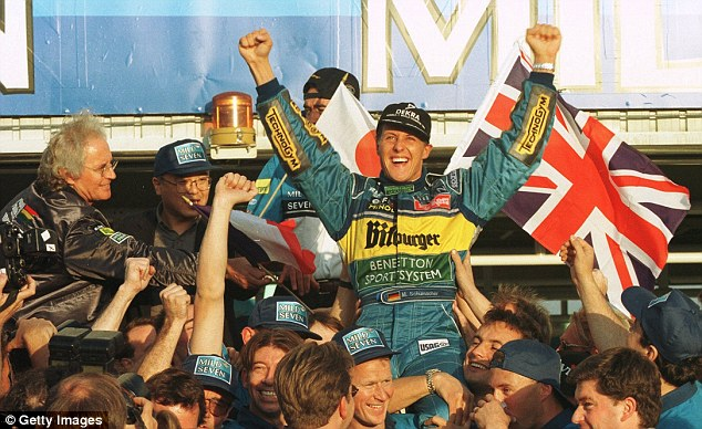 Make mine a double: Schumacher pictured after victory in Suzuka in 1995 to claim his second world title