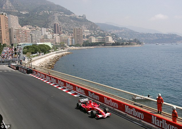 Mean streets: Schumacher patrols the Monaco track ahead of the 2006 race