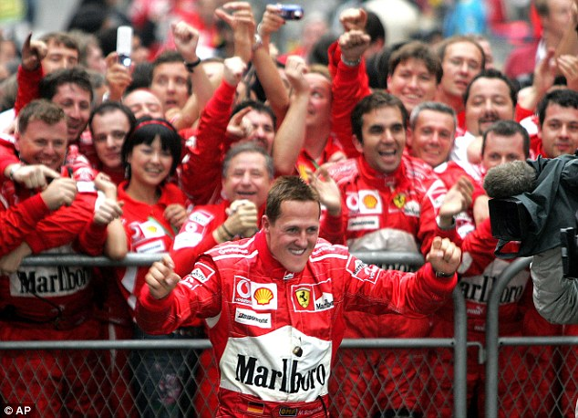 Eastern promise: Schumacher and the Ferrari team hail victory in China