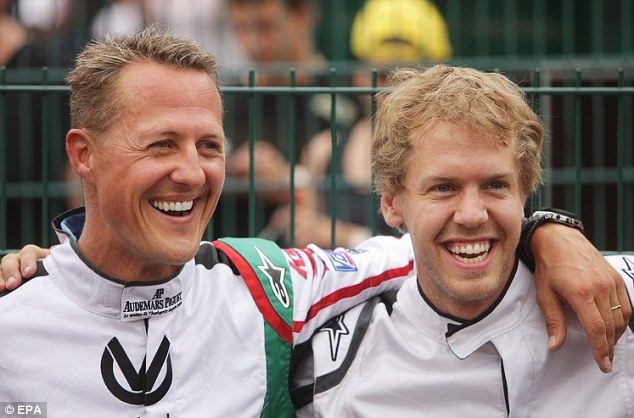 Heir apparent: Schumacher and Sebastian Vettel, who has won four-stright world titles, share a moment at a kart club in Germany in 2001