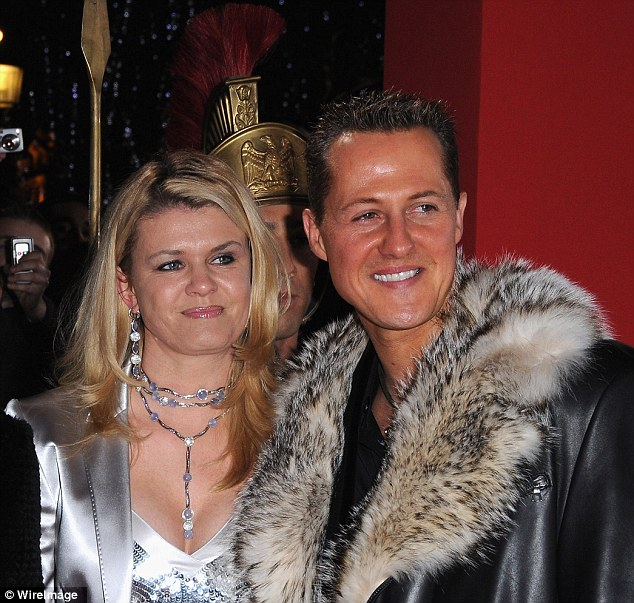 By his bedside: Schumacher's wife Corrina is in Grenoble. The couple married in 1995 and have two children
