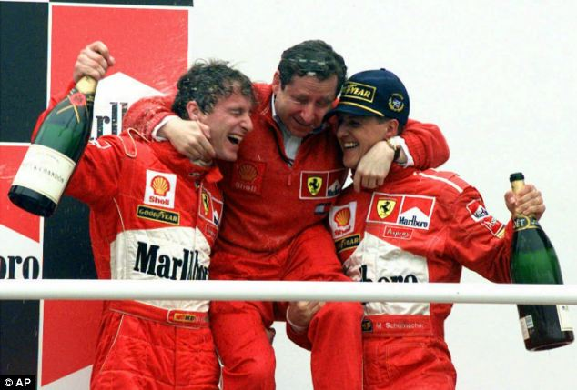 Ferrari engineer Jean Todt, centre, celebrates with Schumacher, right, and Britain's Eddie Irvine after they ended first and third place in the Argentine Formula One Grand Prix on April 12, 1998