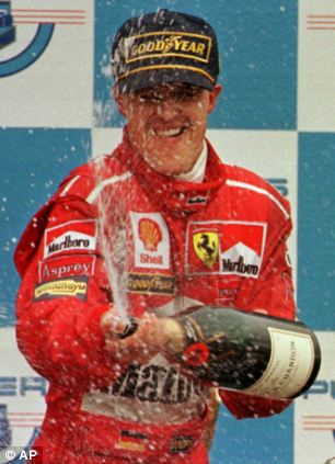 Michael Schumacher jumps for joy on the podium after winning the Canadian Formula 1 Grand Prix in June 1998