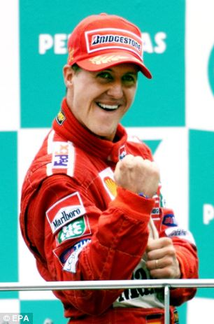 Michael Schumacher on the podium after winning the Malaysian Grand Prix in 2001