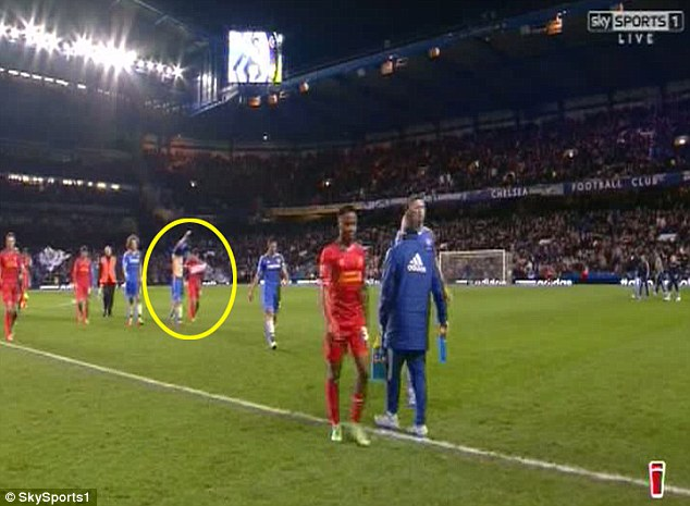 Spotted: Coutinho and Oscar (circled) were also prematurely swapping their jerseys