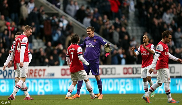 Fortunate? Arsenal's Wojciech Szczesny (centre) nearly gifted Newcastle a goal