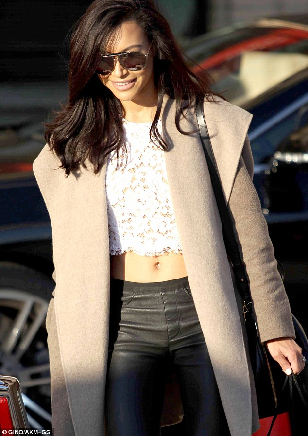Gorgeous! Showing off her flat stomach on December 22