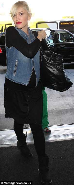 Retro: The 44-year-old singer wore a light blue Eighties styled denim vest with a primarily black ensemble