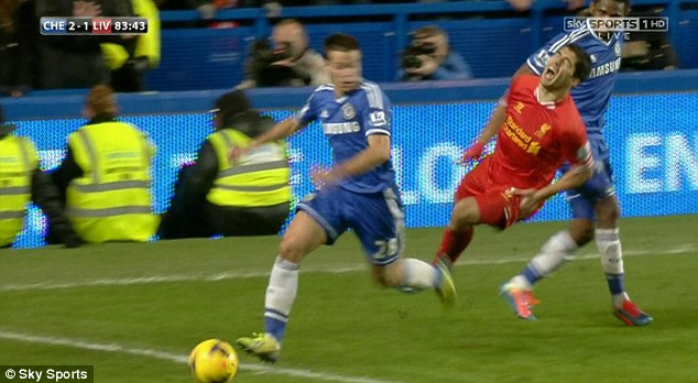 Ouch: Suarez screams in pain as he goes down in Chelsea's penalty area during the second half