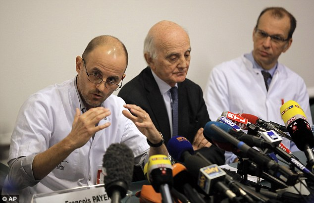 'Working hour by hour': Professor Jean-Francois Payen (pictured, left, with Professors Gerard Saillant and Emmanuel Gay) updates the media on Schumacher's condition at a press conference at the Grenoble Hospital