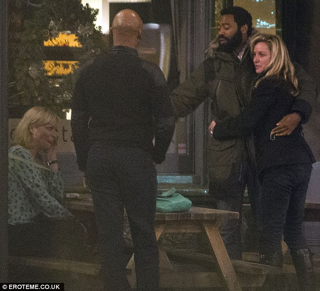 Difficult year: The 43-year-old kept her arms around Nicholas as they chatted outside a restaurant