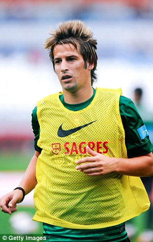 Rusty? Coentrao, pictured here on international duty for Portugal, has only played four times for Real this season