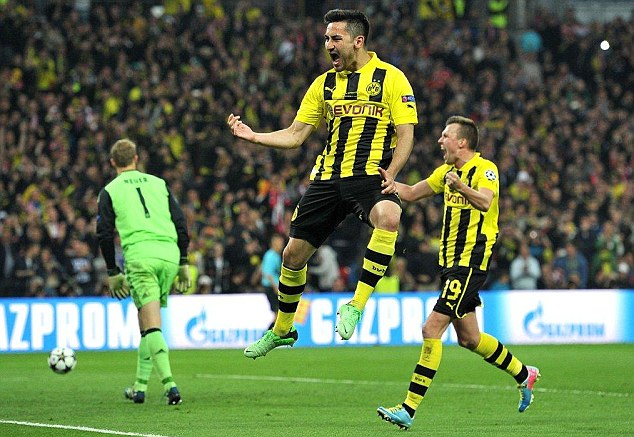 High achiever: Borussia Dortmund's Ilkay Gundogan is staying put in January, his dad has said