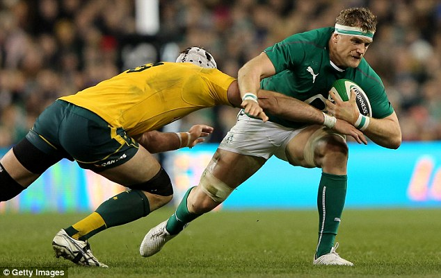 Strength: Ben Mowen (left) tries to tackle Heaslip during match between Ireland and Australia in November