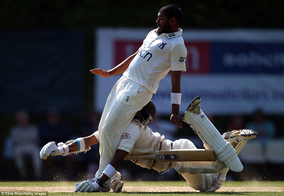 Sore one: Arun Harinath of Surrey collides head first with Jeetan Patel of Warwickshire during day three of their LV County Championship Division One match in July