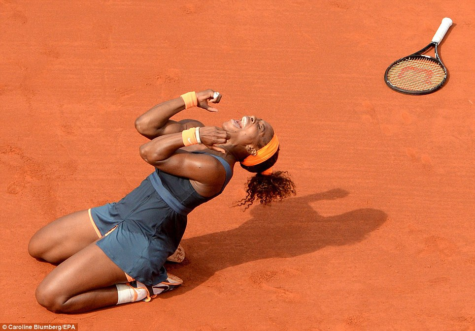 Pure delight: Serena Williams celebrates beating Maria Sharapova in the women's final of the French Open in June. It was the American's 16th Grand Slam title and she went on to win the US Open in September