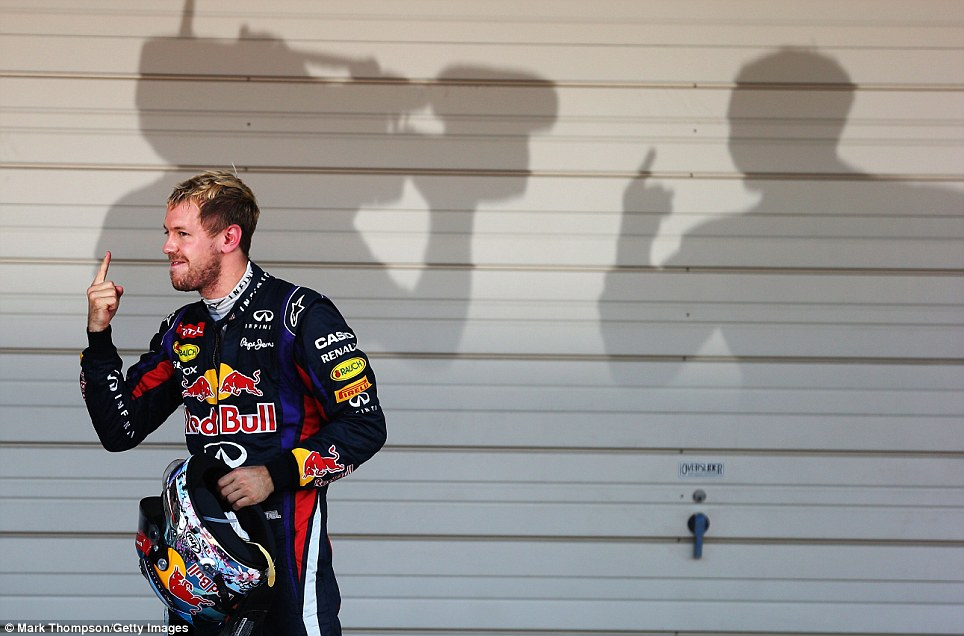 No 1: Red Bull driver Sebastian Vettel celebrates winning the Japanese Grand Prix in October. He went on to clinch the driver's title in India in the next race