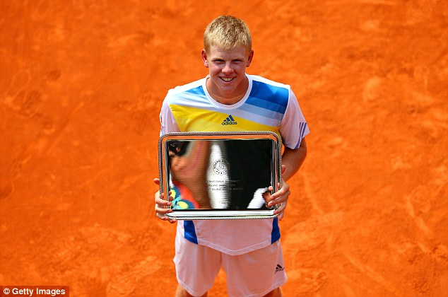 Silverware: Edmund poses with his trophy after winning the boys' doubles at the 2013 French Open