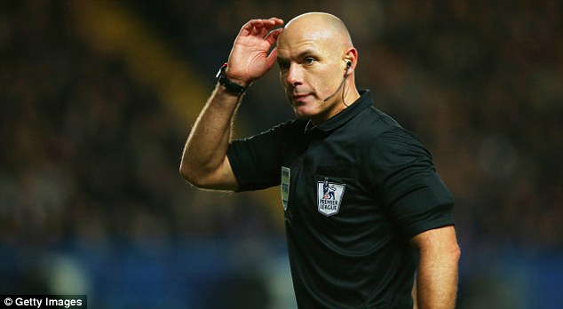 Official: Howard Webb (above) didn't believe Eto'o's challenge on Suarez was a foul