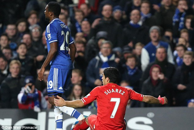 Taking a dive? Jose Mourinho claimed Suarez (centre) fell tp ground like 'an acrobatic swimmer'