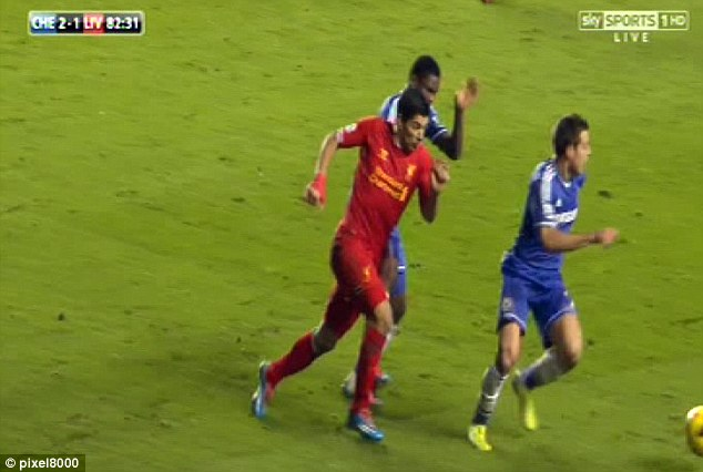 Contact: Eto'o (centre) doesn't believe this tackle on Luis Suarez (left) was a foul