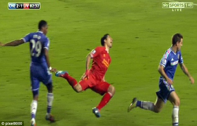 No foul? Suarez (centre) flies through the air after being blocked by Eto'o during Chelsea's win over Liverpool