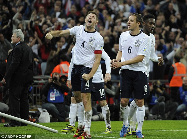 More of this please: Steven Gerrard, Phil Jagielka and Danny Welbeck celebrate England's World Cup spot