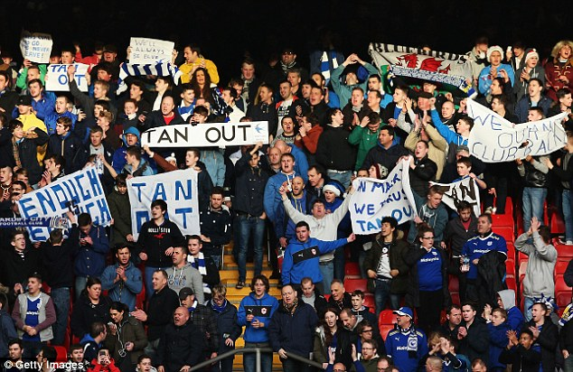 Tan out: Cardiff fans have regularly shown their anger at the club's owner through protests