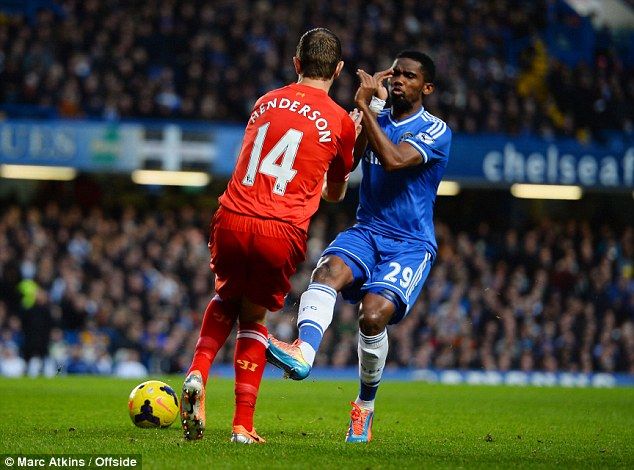 Ouch: Blues striker Eto'o rakes his studs down the shin of Liverpool midfielder Henderson